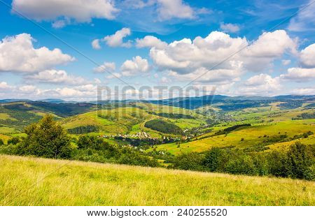Village In The Valley Of Carpathian Mountains. Lovely Countryside Scenery In Early Autumn With Cloud