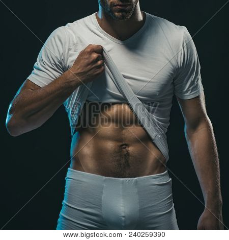 Sexy Erotic Handsome Young Man In Underwear. Muscular Sexy Young Man In White T-shirt Which Shows Th