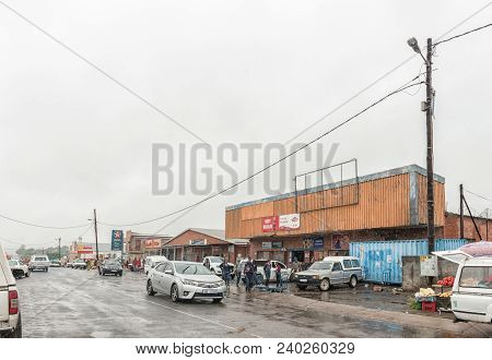 Pomeroy, South Africa - March 22, 2018: A Street Scene With Businesses, Vehicles And People In Pomer