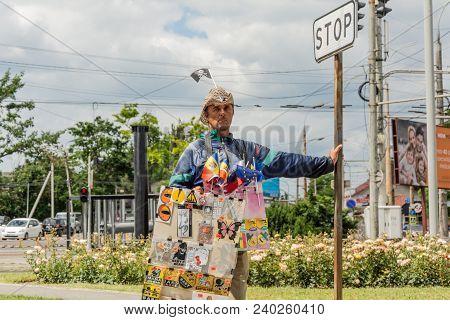 Chishinau, Moldova - June 11, 2017: A Street Vendor Waits For The Cars To Stop. In Chisinau, Street