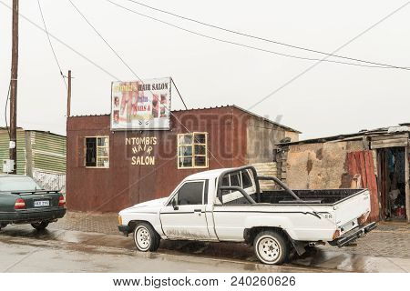 Pomeroy, South Africa - March 22, 2018: A Street Scene With A Hair Salon And Vehicles In Pomeroy In