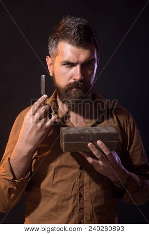 Attractive Yound Barber With Thick Black Beard And Mustache Smiling While Holding Straight Razor Nea