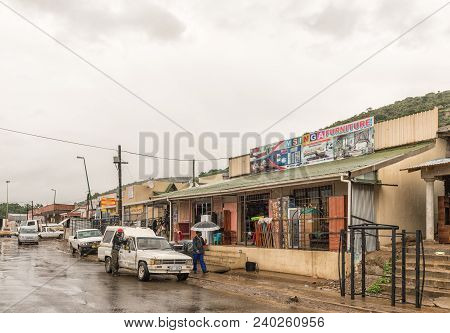 Tugela Ferry, South Africa - March 22, 2018: A Street Scene With Businesses, Vehicles And People In