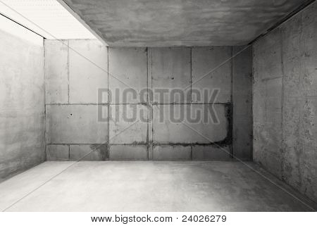 Empty warehouse room with concrete walls and floor.