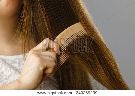 Haircare And Morning Hairstyling Concept. Happy Woman Brushing Her Long Dark Brown Hair