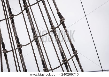 Detailed Closeup Of Mast Rigging On Sail Boat During Cruise. Marine Objects Concept.