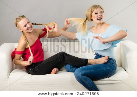 Two Young Pretty Women Being Mad At Each Other Having Argue Fight. Friendship Rivaly And Envy Proble