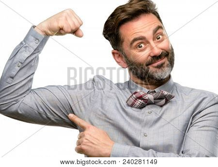 Middle age man, with beard and bow tie pointing biceps expressing strength and gym concept, healthy life its good isolated over white background