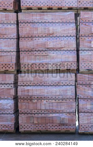 Clay Brick's Pallet At The Storage Yard. Pallets With Bricks In The Building Store. Racks With Brick