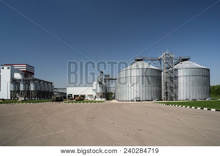 Modern Granary In Animal Feed Factory. Agro-industry Storage Technology. Big Metal Containers For Gr