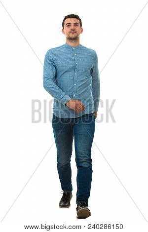 Full Length Portrait Of A Smiling Man Walking Isolated On White Background. Confidence And Charisma.