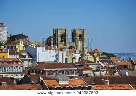 Beautiful View Of The City Of Lisbon, With The Lisbon Cathedral And The Tagus River On The Backgroun