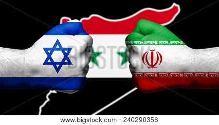 Flags Of Israel And Iran Painted On Two Clenched Fists Facing Each Other With Map Of Syriain The Bac