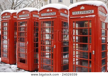 Red telephone box in London. Winter and snow in London poster