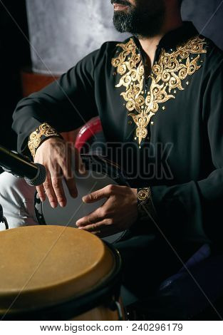 Man Hands Playing Music At Djembe Drums. Musician Playing Congas, Close-up. Rhythm Of Africa, Bongo