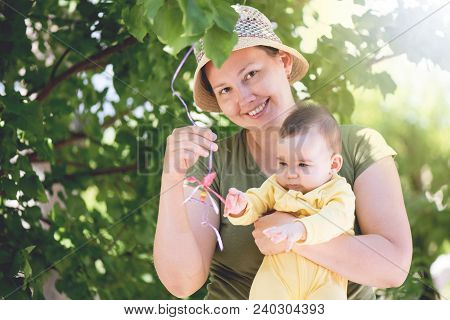 Mother And Baby Portrait Outdoors In Summer