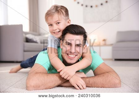 Young man and little boy indoors. Child adoption