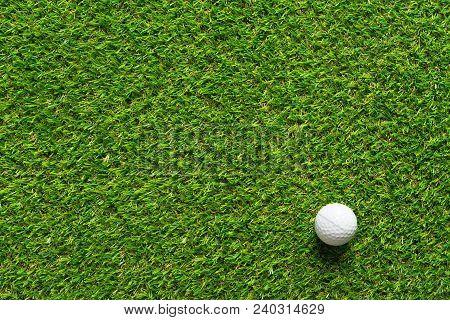 Golf Ball On Green Grass Texture Of Golf Course For Sport Idea Background.