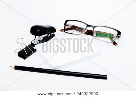 Stationary Concept, Flat Lay Top View Photo Of Pencil, Stapled, Paper Clips, Eyepieces, Notes On Whi