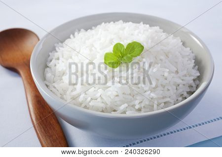 Rice - A Bowl Of Basmati Rice Garnished With Mint.