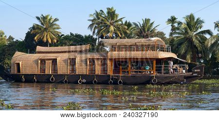 Tourists On Houseboat Floating On Backwaters In Kerala State, South India