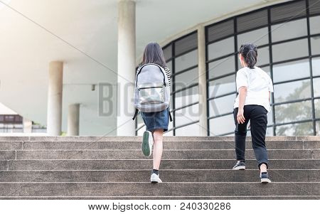 Back To School Education Concept With Girl Kids (elementary Students) Carrying Backpacks Going, Runn