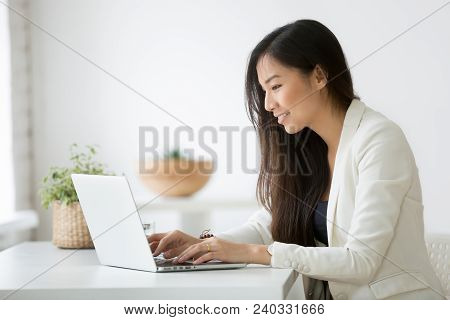 Smiling Young Asian Businesswoman Using Computer At Home Office Workplace, Happy Korean Employee Wor