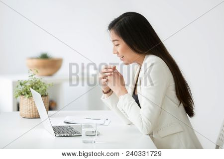 Happy Young Asian Woman Reading Good Online News On Laptop, Motivated Chinese Businesswoman, Student