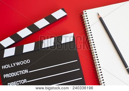Film Clapper On Red Background