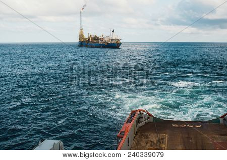 Anchor-handling Tug Supply Ahts Vessel Towing Fpso Tanker. Vessel Is Doing Static Tow Tanker Lifting