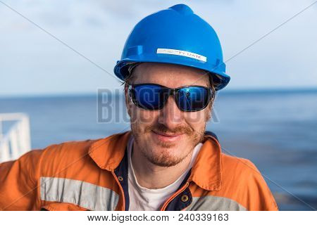 Happy Marine Deck Officer Or Chief Mate On Deck Of Vessel Or Ship , Wearing Ppe Personal Protective