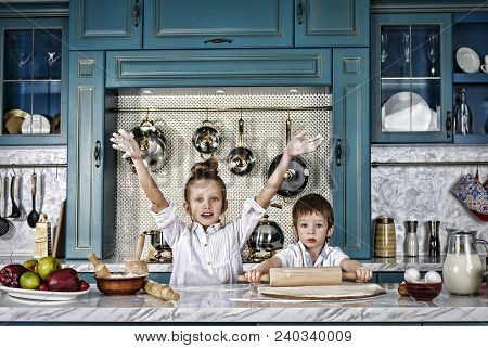 Happy Family Funny Kids Are Preparing The Dough, Bake Cookies In The Kitchen. Casual Still Life Phot
