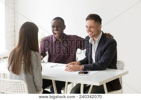 Multiracial Hr Managers Laughing At Funny Humor Joke During Job Interview Talking To Woman Applicant