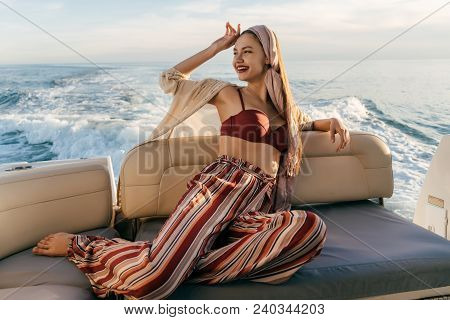 A Luxurious Stylish Girl Relaxes On A Yacht, Went On A Sea Voyage, Laughs