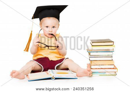 Baby Read Book In Graduation Hat And Glasses, Smart Child Sitting Isolated Over White Background, Ki