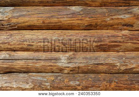 Wooden Logs Wall Texture Background. Log Cabin Or Barn Unpainted Debarked Wall Textured Horizontal B