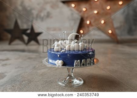 Gourmet Blue Birthday Cake With White Decor And Candle Number One On Glass Stand In Loft Interior. H