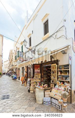 Gallipoli, Apulia, Italy - May 2017 - Traditional Souvenir Shops In The Pedestrian Zone Of Gallipoli