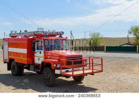 Red Fire Engine For Extinguishing Natural Steppe Or Forest Fires In The National Reserve. The Concep