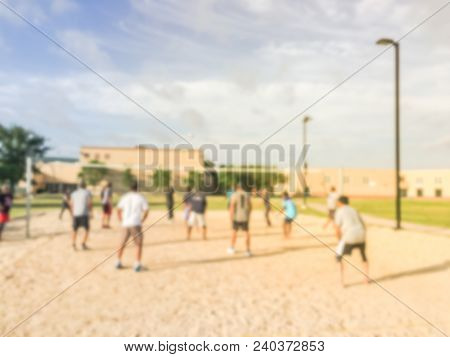 Blurred Indian People Playing Volleyball On Open Air Sand Court In Texas, Usa