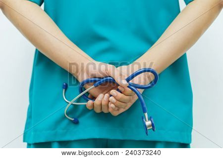Doctors Stand Behind And Cross Hand With Holding Stethoscopes.