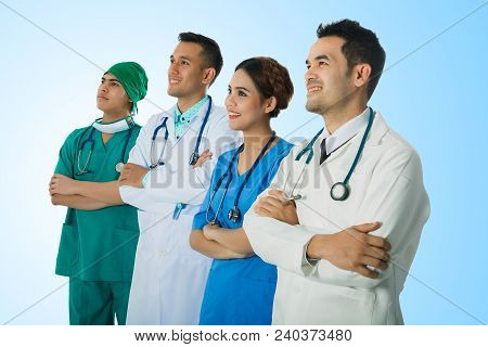 Team Of Doctor And Nurse Posing Arms-crossed Expressing Positive Emotions With Stethoscopes. Isolate