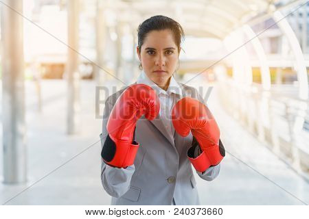 Businesswoman Wearing Boxing Gloves. Concept Of Fighting And Power Business.