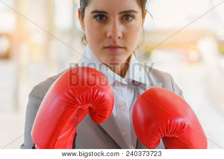 Close-up Hand Of Woman Wearing Boxing Gloves. Concept Of Fighting And Power Business.