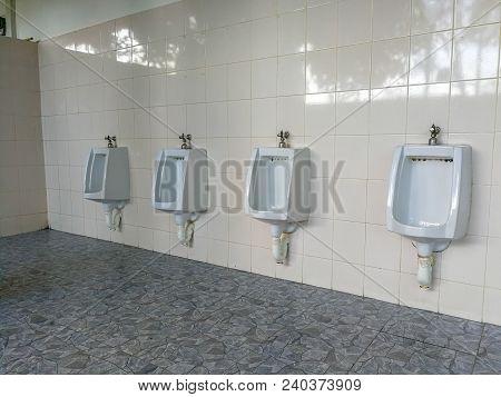 Raw Of Outdoor Urinals Men Public Toilet., Design Of White Ceramic Urinals For Men In Toilet Room. M