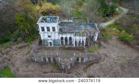 Drone View Of Abandoned Building Of Classical Architecture With Dense Thickets Of Dry Ivy, Sochi, Ru