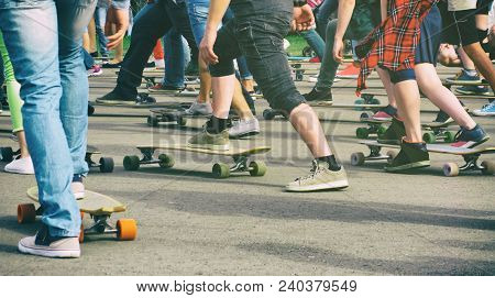 Bottom View Of Young People Group Skating On Skateboards And Longboards. Guys And Girls In Skate Par