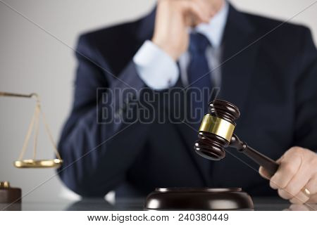 Law Concept. Judge, Gavel, Balance. White Background. Man In Suit.