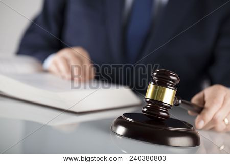 Law Concept. Judge With Gavel, Documents. White Background. Man In Suit.