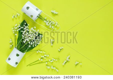Spring Flowers Art Light Concept. Lily Of The Valley On On Bright Green Surface, Top View.